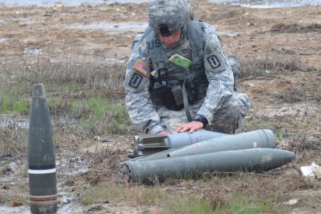 """Sgt. James Swartz, 789th Ordnance Company, works as part of a team to disarm enemy munitions during a fictional scenario that the Soldiers were tasked to complete during the 52nd Ordnance Group's Team of the Year competition in March. Three teams from across the country gathered to compete in the first TOY event since 2001. """""""