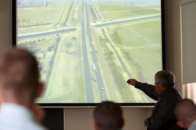 Chris King points to a virtual battlefield depicting a convoy under attack during a virtual staff ride at the George C. Marshall Awards and Leadership Seminar, Tuesday.