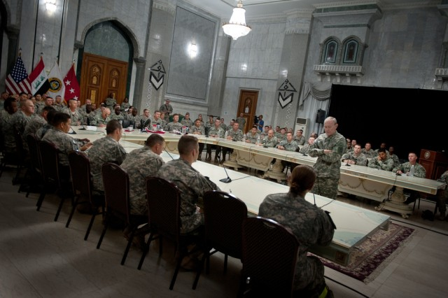 Gen. Martin E. Dempsey, 37th Chief of Staff of the Army, addresses Soldiers deployed in support of Operation New Dawn during a meeting in Camp Victory, Iraq on Apr. 20, 2011.