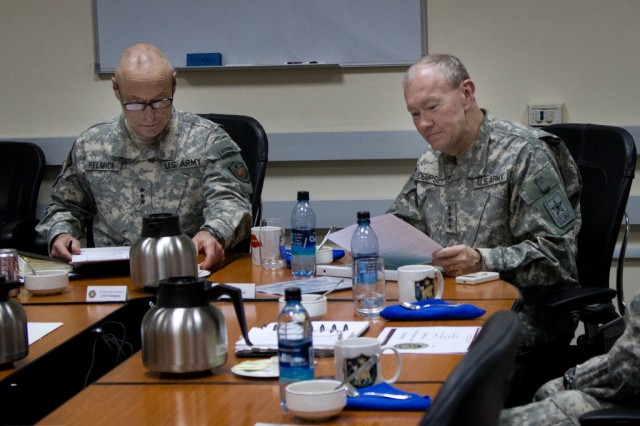 Lt. Gen. Frank Helmick briefs Gen. Martin E. Dempsey on current operations in Baghdad, Iraq on Apr. 19, 2011. Iraq is Dempsey's the first overseas location he has visited since becoming the 37th Chief of Staff of the Army.