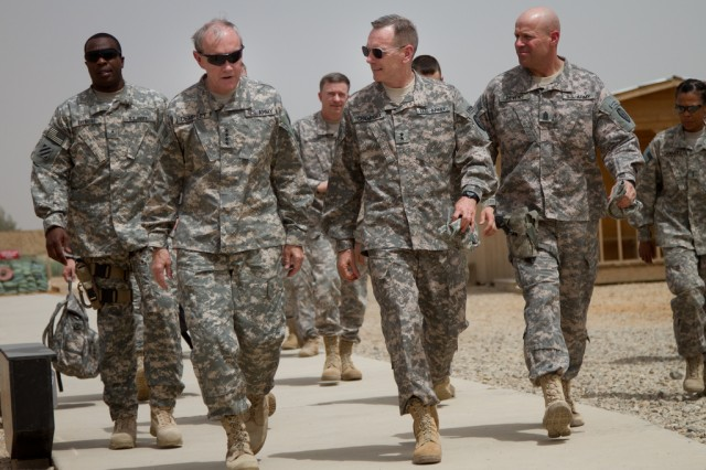 Maj. Gen. Bernie Champoux, Commanding Gen. of the 25th Infantry Division, talks with Gen. Martin E. Dempsey, Chief of Staff of the Army, at Camp Victory, Iraq on Apr. 19, 2011. Iraq is Dempsey's the first overseas location he has visited since becoming the 37th Chief of Staff of the Army.
