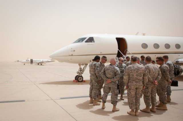 Gen. Martin E. Dempsey, Chief of Staff of the Army, talks with service members after he lands at Al Asad, Iraq on Apr. 19, 2011. Iraq is Dempsey's the first overseas location he has visited since becoming the 37th Chief of Staff of the Army.