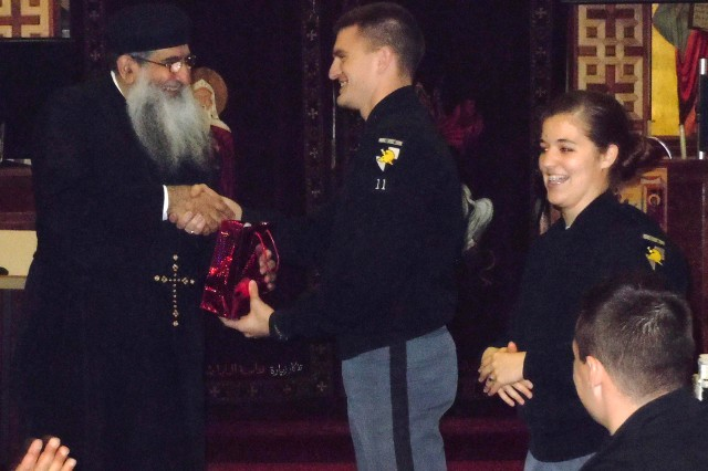"Class of 2011 Cadets Jeremy Smith and Catie Beal thank Father David Bebawy for inviting the class of ""Winning the Peace"" into St. George and St. Shenouda, an Egyptian Coptic Orthodox Church in Jersey City, and for providing a deeper understanding of the Coptic religion."