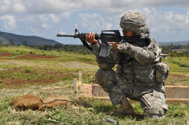 SCHOFIELD BARRACKS, Hawaii -- Spc. Dana Tamayo fires rounds from the crouching position during the M16 qualification portion of this year's 9th Mission Supp Support Command's Best Warrior Competition, here, April 22.