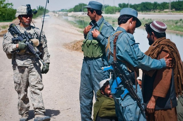 Coaltion forces searching civilians