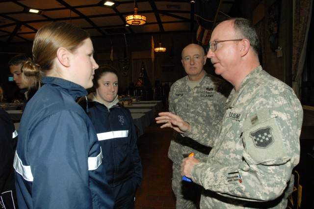 Maj. Gen. William D. Razz Waff, commanding general, 99th Regional Support Command, right, and Chief Warrant Officer Five Jim Thompson, command chief warrant officer, Army Reserve and U.S. Army Reserve Command, offer career information and opportunities to a pair of midshipmen at the U.S. Merchant Marine Academy in Kings Point, N.Y., March 24. Academy graduates are not only qualified for civilian careers on ships, but they also have to fulfill an eight-year commitment to the military that can be served as a commissioned officer or warrant officer in the Army Reserve. For more information, please e-mail shawn.morris1@usar.army.mil or BurgosL@USMMA.EDU.
