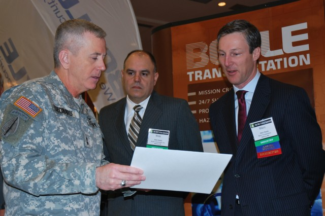 "Maj. Gen. Kevin Leonard, commanding general, Military Surface Deployment and Distribution Command, presents a ""Patriotic Employer"" certificate to Marc D. Boyle (far right), President of Boyle Transportation, Inc., during the 2011 SDDC Training Symposium in Dallas, Texas, April 4-6. The company earned the recognition for the support they provided to one of their employees, Lt. Col. Rick Araniz (center), while he was deployed last year in support of Operation Enduring Freedom."