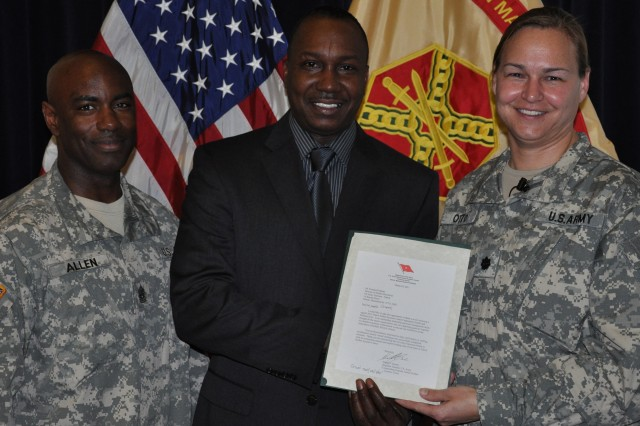 Awards presentations led off the April 19 Garrison Town Hall at U.S. Army Garrison-Natick. Among those recognized was Emanuel Ingram, director of Human Resources, flanked by Lt. Col. Kari K. Otto, garrison commander, and Command Sgt. Major Earl B. Allen.
