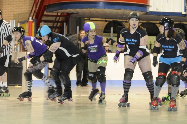 Black River Rollers from left, Whitney Walker, Amanda Moore and Kristy Pastrano, all military spouses, block the Wilkes-Barre Scranton Roller Radical skaters during Saturday's bout at the Watertown Arena.