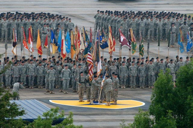 Lt. Gen. Don Campbell Jr. accepts the III Corps colors from Gen. James D. Thurman, commanding general, U.S. Army Forces Command, during a change of command ceremony at Fort Hood, Texas, April 21, 2011. Campbell assumed command of III Corps and Fort Hood from Lt. Gen. Bob Cone.