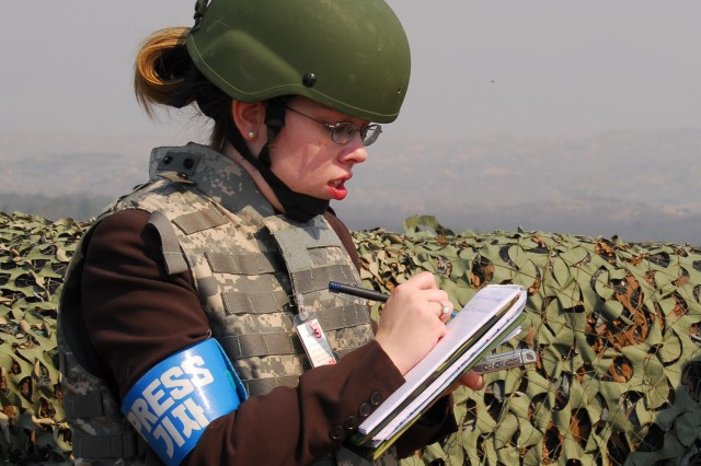 The author, Elizabeth M. Collins, on assignment for Soldiers magazine at the Demilitarized Zone in Korea.