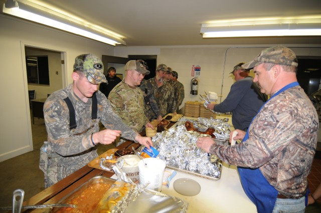 MILAN, Tenn. - Volunteers serve hunters and guides at the Tennessee National Guard barracks in Lavinia, Tenn. Both hunters and guides participated in the National Wild Turkey Federation's Wounded Veteran Turkey Hunt at Milan Army Ammunition Plant on March 19-20, 2011.