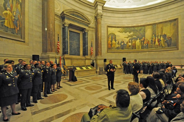 The rotunda of the National Archives provides a backdrop April 21 for 56 Army Reserve Soldiers to re-enlist on the Army Reserve's 103rd birthday. Lt. Gen. Jack C. Stultz, commander, U.S. Army Reserve, administered the oath of enlistment to the Soldiers. The National Archives houses the originals of the Declaration of Independence, the first and last pages of the Constitution and the Bill of Rights.