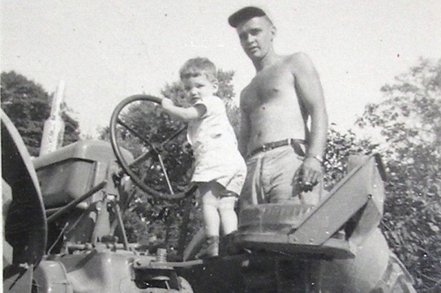 Rob McIlvaine is ready to take to the fields with his dad, Bill, a former chief quartermaster with the U.S. Navy in the South Pacific during World War II.