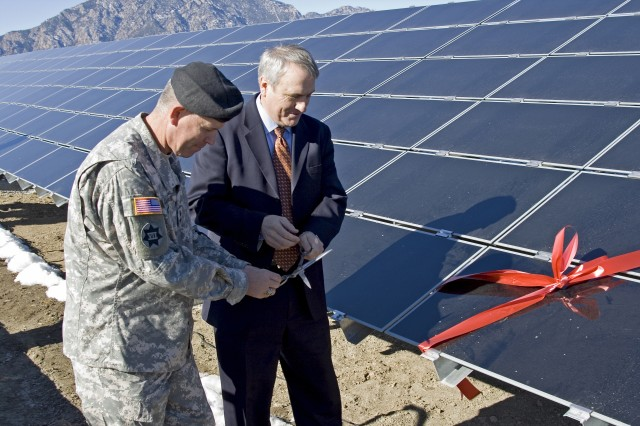 Colorado Gov. Bill Ritter Jr. and Maj. Gen. Mark A. Graham, commanding general, Division West, First Army and Fort Carson, prepare to cut the ribbon on the Fort Carson solar array Jan. 14, 2008.