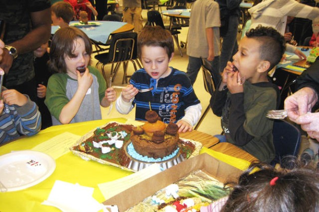 "Students from Manor View Elementary School ""dive in"" to eat the desserts of other competitors and ones they made themselves after winners from each grade category were announced during the Edible Art Contest. The competition, which attracted more than 50 competitors, had ""winners"" in each age category."