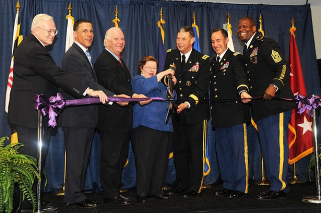 Sen. Barbara A. Mikulski cuts the ribbon with DISA Director Army Lt. Gen. Carroll Pollett. The Defense Information Systems Agency held its ribbon-cutting ceremony April 15 to celebrate the official opening of its new facility at Fort Meade. The event was held in the conference center of the main building on the 95-acre campus. Also pictured above are DISA Base Realignment and Closure Executive Dave Bullock, Lt. Gov. Anthony Brown, Sen. Ben Cardin, Installation Commander Col. Daniel L. Thomas and DISA Senior Enlisted Advisor Command Sgt. Maj. Donald Manley.