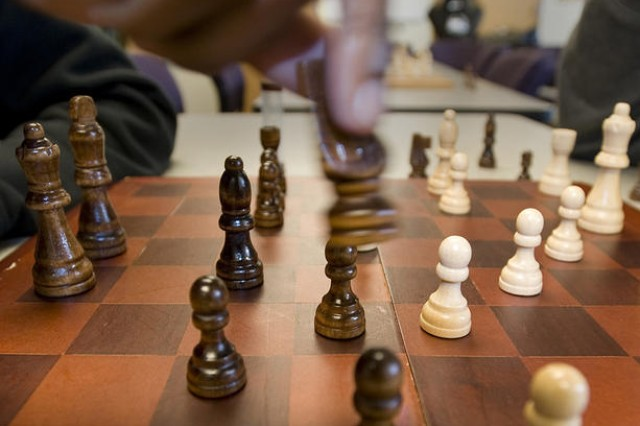 Replacing a video game controller with a chess knight provided a hands-on experience for players at the first-ever Fort Meade Teen Center chess tournament.