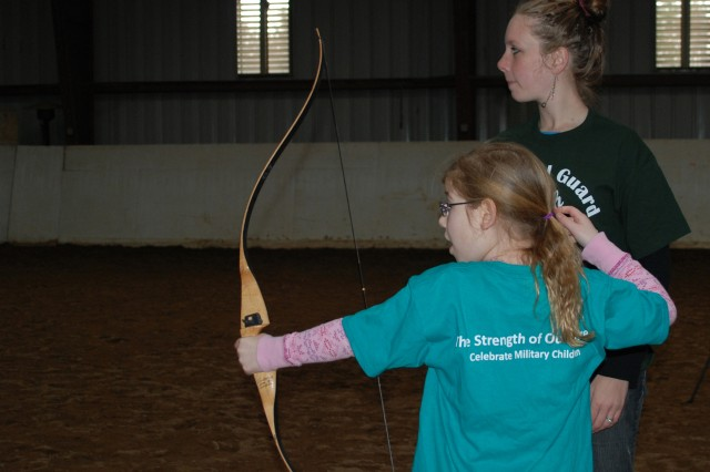 Lisa Charbonneau (right), a 4-H volunteer archery instructor, teaches Amy Baldwin, 7, how to properly hold and shoot an arrow during the N.Y. National Guard Family and Youth Training Workshop, April 16, 2011. The N.Y. National Guard Youth program provides support and skills training in leadership, mentoring and resource coordination that reflect the unique needs of military children. The program provides safe activities and a place to meet, talk and have fun with other military children while addressing deployment issues, such as separation anxiety, increased responsibility and reintegration when a loved one returns home.