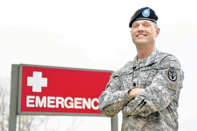 Lt. Col. Timothy Barron, Emergency Room department head of DeWitt Army Community Hospital, Fort Belvoir, Va., delivered a baby in the hospital's parking lot April 6, 2011, after the expectant mother was unable to make it into the ER.