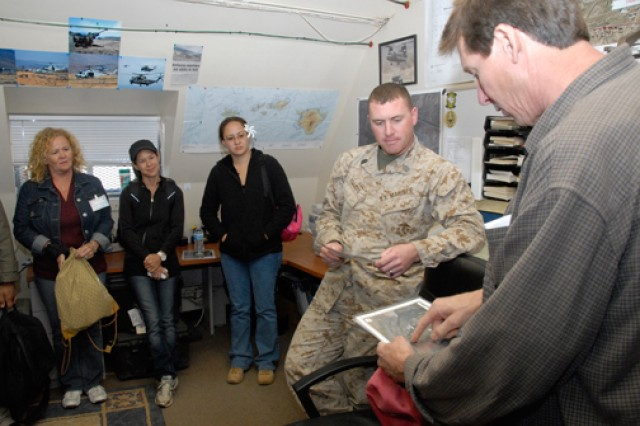 POHAKULOA TRAINING AREA, Hawaii - Dr. Peter Peshut (right), biologist, Natural Resources Section, Environmental Div., DPW, USAG-PTA, briefs candidates in the USAG-HI Fellows Program from Schofield Barracks, as Marine Gunnery Sgt. Andrew Yellope looks on, April 20.