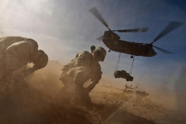 Chinook slingloading a Humvee