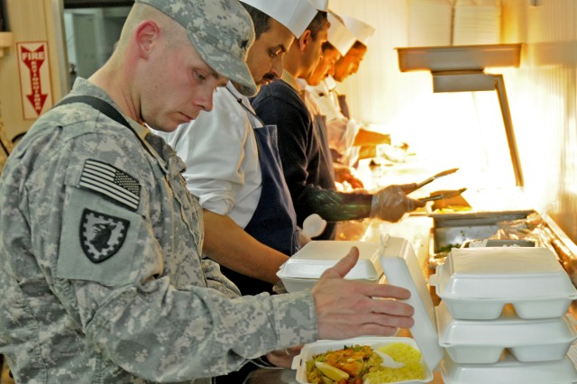 Sgt. Jeremy McPhail a detainee dining facility noncommissioned officer-in-charge with HHC, 40th MP Bn., inspects a food plate prepared for detainees at Camp Cropper. McPhail worked hand-in-hand with the Iraqi bi-lingual and bi-cultural advisors, dieticians, and nutritionist to enhance the detainee food program.