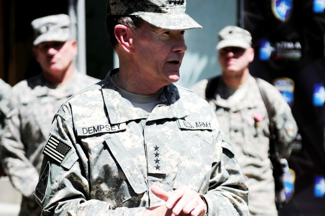 """Gen. Martin E. Dempsey, new Chief of Staff, addresses troops after an award ceremony at Camp Eggers, April 21. Dempsey succeeded Gen. George W. Casey Jr. as the Army chief of staff April 11.  """"Our goal is to visualize what the Army may be like in the year 2020 and build an organization that supports versatility,"""" said Dempsey """"The Army has to have structure and stance, like a boxer, to be able to do whatever the nation needs it to do."""""""