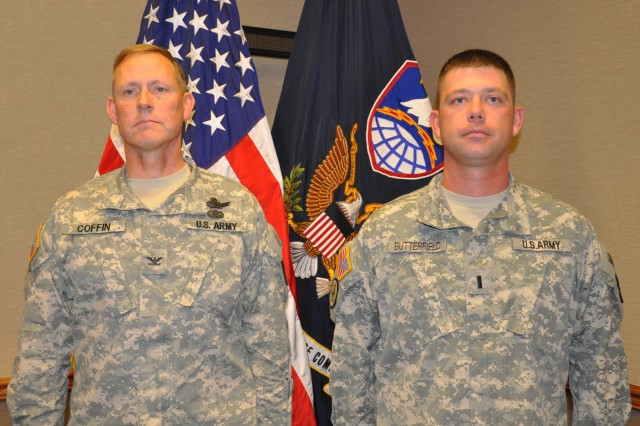 Lt. Harold Butterfield, right, stands at attention with Col. Timothy Coffin, deputy commanding officer for operations, U.S. Army Space and Missile Defense Command/Army Forces Strategic Command, as the orders promoting Butterfield to captain are read aloud during a ceremony in Colorad Springs, Colo., April 22. Butterfield serves as Coffin's aide.