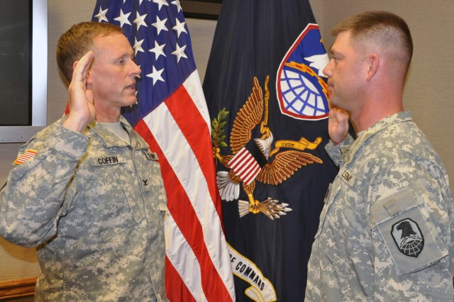 Newly promotoed Capt. Harold Butterfield recites the Oath of Office, administered by Col. Timothy Coffin, deputy commanding officer for operations, USASMDC/ARSTRAT, during a ceremony on April 22 at Peterson Air Force Base, Colo.