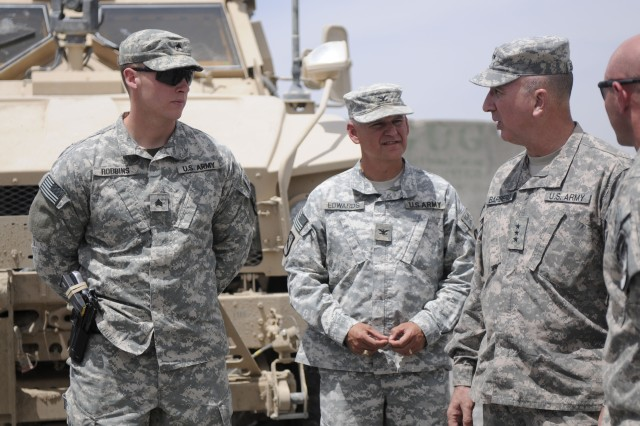 SPIN BOLDAK, Afghanistan-Sgt. Logan Robbins, assistant team leader speaks to Col. James Edwards, commander, 525th Battlefield Surveillance Brigade and LT. Gen. Michael Barbero, director, Joint Improvised Explosive Device Defeat Organization, during a visit to Spin Boldak Afghanistan, April 24, 2011. (Photo by Staff Sgt. LaSonya Morales, 16th Mobile Public Affairs Detachment)
