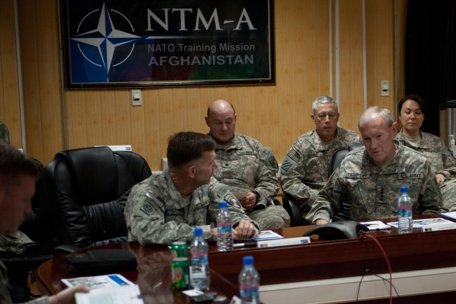 Gen. Martin E. Dempsey, chief of staff of the Army, receives a brief on the NATO Training Mission by Lt. Gen. William Caldwell and his staff at Camp Eggers, Afghanistan, April 21, 2011.