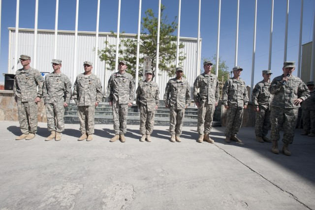 Army Chief of Staff Gen. Martin E. Dempsey  congratulates Soldiers from the 10th Combat Aviation Brigade after presenting them with valor awards at a ceremony held at 101st Airborne Division Headquarters. Dempsey presented the awards during a visit to Bagram Airfield, Afghanistan, April 21, 2011.