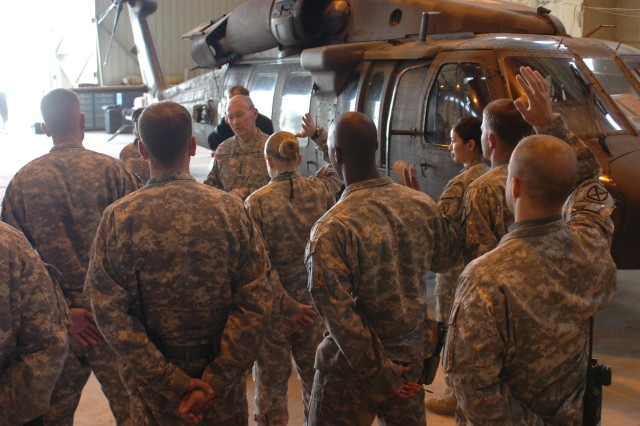 Army Chief of Staff Gen. Martin E. Dempsey asks for a show of hands of who deployed with less than 10 months dwell time, on his visit with Company C, Task Force Phoenix, 10th Combat Aviation Brigade, 10th Mountain Division, April 22, 2011, at the medical evacuation unit's hanger. Several medevac Soldiers returned with the unit just 10 months prior to their most recent deployment.