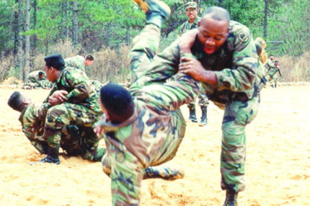 Soldiers of the Louisiana National Guard, 527th Engineer Battalion, conduct combatives training at fort Polk in 1991.