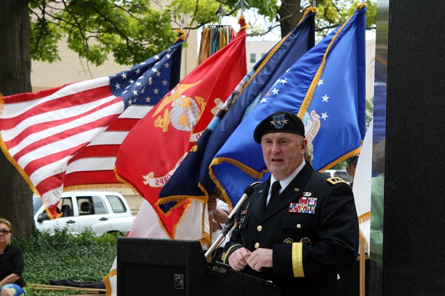 FORT SAM HOUSTON, Texas - Lt. Gen. Rick Lynch, the commanding general for U.S. Army Installation Command, speaks to those gathered for the All Veterans Memorial Service at the Vietnam Memorial April 17 in San Antonio. Lynch served as the event's guest speaker. The memorial service served to honor veterans - both past and present. During the ceremony, military and civilian community members placed wreaths, bouquets and flowers at the base of the Vietnam Memorial in memory of those who have served.