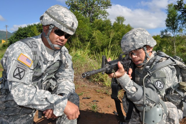 SCHOFIELD BARRACKS, Hawaii -- 1st Sgt. Gerard Damian, first sergeant for the 797th Engineer Company, helps Sgt. Gerald Manansala, an interior electrician for the 797th, steady his trigger squeeze by placing a dime on Manansala's rifle barrel prior to the rifle qualification portion of the 9th Mission Support Command's Best Warrior competition, here, Friday.