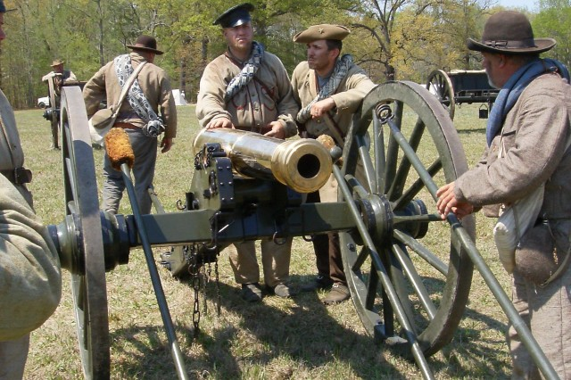 Stephen Hutson, second from right, helps man a six pounder field gun during a documentary filming of the Battle of Shiloh near Savannah, Tenn. Filming occured from March 24-27 and April 7-10. Hutson is a general engineer with the U.S. Army Space and Missile Defense Command/Army Forces Strategic Command.