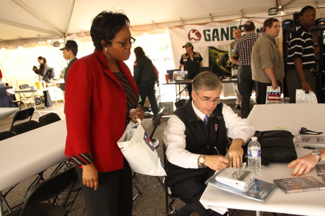 WHNT's meteorologist Dan Satterfield signs an autograph during the 2010 joint U.S. Army Space and Missile Defense Command/Army Forces Strategic Command and Missile Defense Agency Safety Day. Satterfield is expected to return for this year's