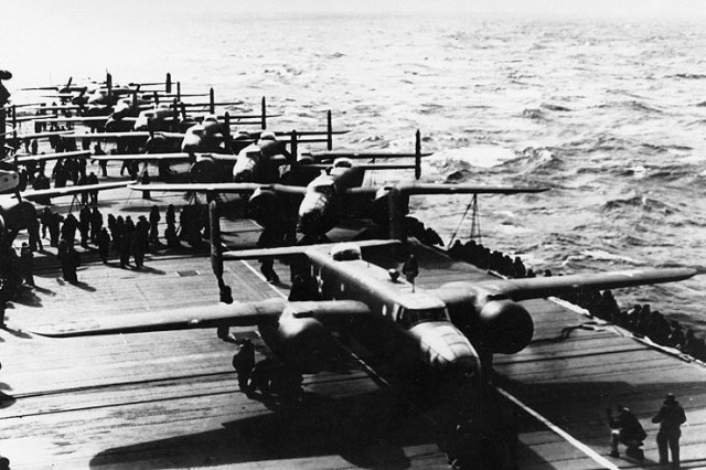 B-25 Mitchell bombers on board the USS Hornet ready to launch into the wind after being spotted by a Japanese picket boat.
