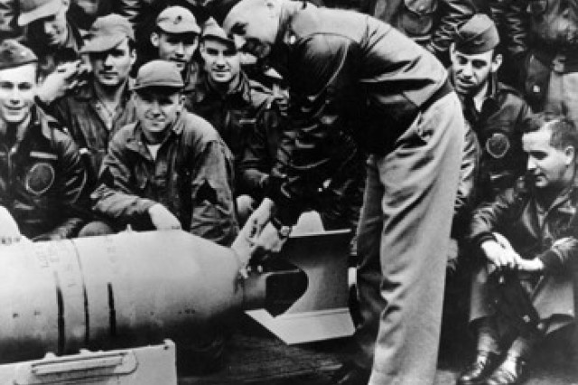 Lt. Col. Doolittle wires a Japanese medal to a bomb before the Japan raid, April 1942.