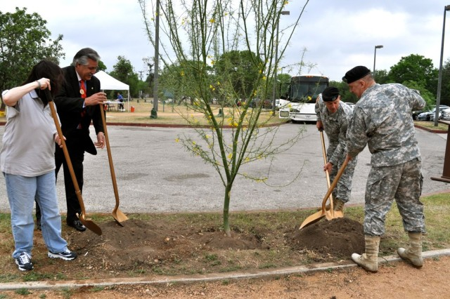 The Hon. Katherine Hammack, Mayor Pro-tem Ray Lopex, Col. Scott Kimmel and Lt. Gen. Rick Lynch dedicate the IMCOM tree, a palo verde, during Earth Day at John James Park.