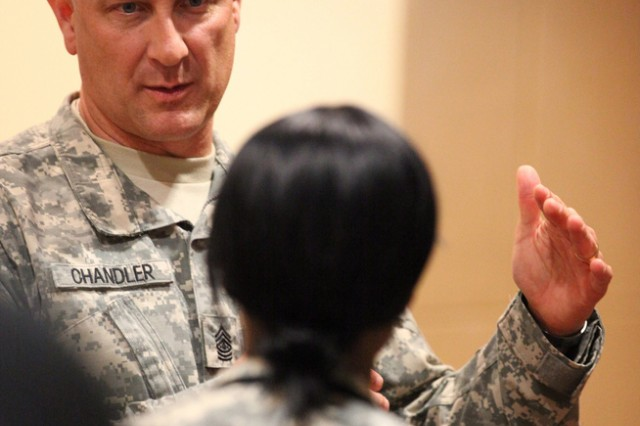 Sgt. Maj. of the Army Raymond F. Chandler III speaks with representatives from Better Opportunities for Single Soldiers at the 2011 Installation Management Command Symposium in San Antonio, Texas. (U.S. Army photo)