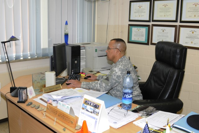 Chief Warrant Officer 4 Jose M. Agosto, Chief of the 7th Army Joint Multinational Training Command Organizational Maintenance Activity (OMA) works at his desk. The OMA was selected as the 1st place winner in the Department of Army Award for Maintenance Excellence for fiscal year 2010. Along with field maintenance support, OMA is responsible for ordering Class III (P) packaged petroleum products and Class IX repairs parts and supplies for the JMTC, while providing area recovery and maintenance support to units who train at the Grafenwoehr Training Area.