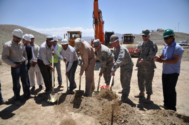 """KABUL - The U.S. Army Corps of Engineers broke ground on a $5.5 million ammunition bunker project located in the Pol-e-Charki province of Kabul in support of the Afghanistan National Army, April 26. Twenty-five ammunition bunkers will be built at the ANA military compound and will be used to safely store explosives, and artillery. Currently the ammunitions are being stored in un-cooled storage containers which could potentially be dangerous under certain conditions. Additionally, the Corps will be managing the construction of an aggregate roadway on the project site. """"This team of warriors will work and partner together to get this project done on time and with quality construction,"""" said Lt. Col. Steve Danner, the Afghanistan Engineer District North's Kabul area office officer in charge. Hashmat Khalil Rezai Construction Co., located in the Parwan District of Kabul is the contractor on the project. Between 80 and 100 Afghan construction workers will be employed during the duration of the construction project. The project is expected to be complete in May 2012. The Corps of Engineers is the primary organization building army bases, police stations, roads, airstrips and other infrastructure projects in Afghanistan to increase the country's stability and economy. It has two districts in the country - Afghanistan Engineer District-North, which is based in Kabul; and Afghanistan Engineer District-South, which is based in Kandahar."""