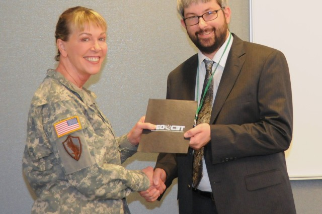 "Mr. Jeffrey ""Thom"" Hawkins (right), program analyst for Program Executive Office Command, Control, Communications-Tactical (PEO C3T) Business Management Division, Program Analysis Branch, received an honorary One Star Note from Brig. Gen. N. Lee S. Price, PEO for C3T, for his Lean Six Sigma Efforts."