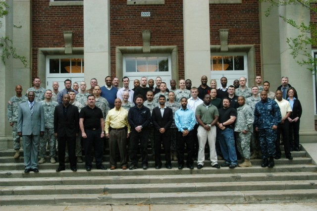 "The JFHQNCR/MDW Anti-terrorism Branch chief, Marvin Solomon, (wearing a suit) stands with the most recent graduating ""Unit Anti-terrorism officer Course"" at Fort Belvoir, 22 Apr. 2011.  This course prepares Anti-terrorism Officers with the skills and knowledge required to be an advisor to the commander and provide anti-terrorism awareness training.  Look for a detailed story in the next issue of the Pentagram."