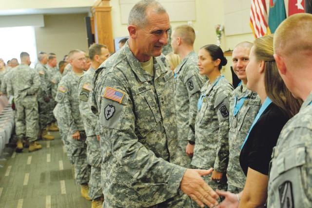 Maj. Gen. Robert Brown congratulates honorees.