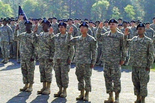 Soldiers at Fort Jackson, S.C., are sworn in during a naturalization ceremony in 2010.
