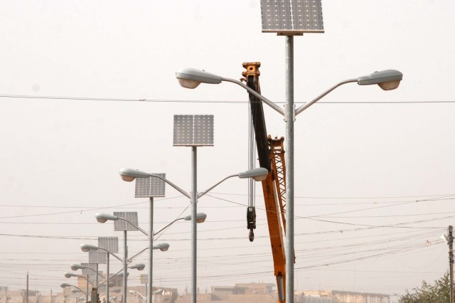 Solar panels power more than 1,200 street lights, providing illumination for more than 35 kilometers of roadway, in and around Fallujah, Iraq.
